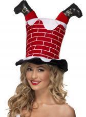 chapeau de pere noel tombe dans la cheminee