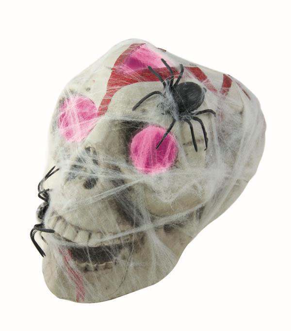 crâne en plastique lumineux avec toile et araignées halloween